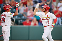 Springfield Cardinals second baseman Dickie Joe Thon (35) is congratulated by Oscar Mercado (26) after hitting a home run in the bottom of the fifth inning during a game against the Corpus Christi Hooks on May 30, 2017 at Hammons Field in Springfield, Missouri.  Springfield defeated Corpus Christi 4-3.  (Mike Janes/Four Seam Images)
