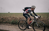 Emīls Liepins (LAT/Trek - Segafredo)  experimenting with new ways of wearing his rain jacket<br /> <br /> 118th Paris-Roubaix 2021 (1.UWT)<br /> One day race from Compiègne to Roubaix (FRA) (257.7km)<br /> <br /> ©kramon