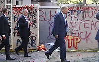 United States President Donald J. Trump passes graffiti as he walks from the White House to pose with a bible outside St. John's Episcopal Church after delivering remarks in the Rose Garden at the White House in Washington, DC, USA, 01 June 2020. Trump addressed the nationwide protests following the death of George Floyd in police custody.<br /> Credit: Shawn Thew / Pool via CNP/AdMedia