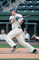 Designated hitter Blaise Salter (11) of the Michigan State Spartans bats in a game against the Harvard Crimson on Saturday, March 15, 2014, at Fluor Field at the West End in Greenville, South Carolina. Michigan State won, 4-0. (Tom Priddy/Four Seam Images)