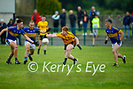 All eyes on the ball as Darragh Lynch of Listowel and Kieran O'Donoghue, Denis O'Connor and team mate Chris O'Donoghue of Glenflesk bare down on him, in the Div 3 of the County football league