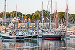 Sailboats at sunrise in Camden, Maine, USA