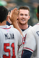 Second baseman Greg Cullen (18) of the Rome Braves is greeted after scoring a run in a game against the Columbia Fireflies on Tuesday, June 4, 2019, at Segra Park in Columbia, South Carolina. Columbia won, 3-2. (Tom Priddy/Four Seam Images)