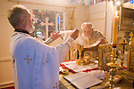 Liturgy service at St. Sava Orthodox Church, Jackson, Calif...Father Stephen Tumbas assists Very Reverend Stavrofor Miladin Garich in preparing the sacramental wine at the altar