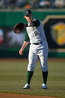 Allan Dykstra #10 of the Fort Wayne Tin Caps warms-up in the outfield at Parkview Field April 16, 2009 in Fort Wayne, Indiana. (Photo by Brian Westerholt / Four Seam Images)