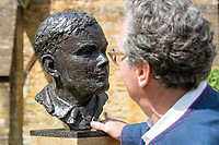 BNPS.co.uk (01202) 558833. <br /> Pic: CorinMesser/BNPS<br /> <br /> Pictured: Sculptor David Williams-Ellis with the bust. <br /> <br /> A magnificent bronze bust of Enigma codebreaker Alan Turing has today gone on display at his former school.<br /> <br /> The bust, which is just over life size, stands on a plinth at Sherborne School in Dorset, where the genius mathematician and father of computer science was a pupil from 1926 to 1931.<br /> <br /> It was unveiled by Turing's nephew and fellow Sherborne School alumni, author Sir John Dermot Turing.<br /> <br /> During the Second World War Turing worked for the Government Code and Cypher School (GC&CS) at Bletchley Park, Bucks, Britain's code-breaking centre. He played a pivotal role in cracking the German Enigma code that enabled the Allies to defeat the Nazis in many crucial battles.<br /> <br /> The bust has been fashioned by acclaimed sculptor David Williams-Ellis, who has previously commemorated the D-Day landings in sculpture for the Normandy Memorial Trust.