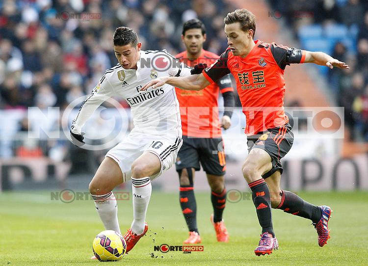Real Madrid's James Rodriguez (l) and Real Sociedad's Sergio Canales during La Liga match.January 31,2015. (ALTERPHOTOS/Acero) /NortePhoto<br /> /NortePhoto.com