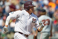 Mississippi State outfielder Hunter Renfroe (34) rounds the bases after hitting a three run home run in the fifth inning of Game 11 at the 2013 Men's College World Series against the Oregon State Beavers on June 21, 2013 at TD Ameritrade Park in Omaha, Nebraska. The Bulldogs defeated the Beavers 4-1, to reach the CWS Final and eliminating Oregon State from the tournament. (Andrew Woolley/Four Seam Images)