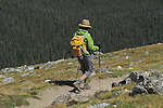 Caucasian person hiking the Flattop Mountain Trail in Rocky Mountain National Park, west of Estes Park, Colorado.