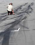 05 Apr 2009, Kuala Lumpur, Malaysia --- A FIA staff check the temperature of the track before the 2009 Fia Formula One Malasyan Grand Prix at the Sepang circuit near Kuala Lumpur. Photo by Victor Fraile --- Image by © Victor Fraile / The Power of Sport Images
