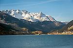 Italy, South-Tyrol (Alto Adige - Trentino), Vinschgau (Val Venosta), Resia: at Lago di Resia (German: Reschensee), at background snowcapped summits of Sesvenna Alps | Italien, Suedtirol, Vinschgau, Reschen am See: liegt am noerdlichen Ende des Reschensees und gehoert zur Gemeinde Graun, dahinter die schneebedeckten Gipfel der Sesvennagruppe