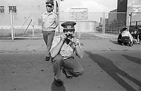 """- Berlin, international march for peace, protesters block border crossing through the Wall """"Checkpoint Charlie"""" and are cleared by the police of the GDR (August 1978)<br /> <br /> - Berlino, marcia internazionale per la pace, i dimostranti bloccano il passaggio di frontiera attraverso il Muro """"Checkpoint Charlie"""" e vengono sgomberati dalla polizia di frontiera della DDR (agosto 1978)"""