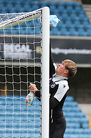 A member of ground staff cleans the crossbar with disinfectant prior to kick-off during Millwall vs Middlesbrough, Sky Bet EFL Championship Football at The Den on 8th July 2020