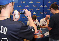 Members of the Atlanta Braves sign autographs for fans on January 27, 2012 at Academy Sports and Outdoors in Spartanburg, South Carolina. It was the first day of the 2012 Braves Country Caravan, which visits cities all across the South prior to Spring Training. (Tom Priddy/Four Seam Images)