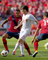 Spain forward David Silva (21) passes the ball as USA midfielder Jermaine Jones (13) defends. In a friendly match, Spain defeated USA, 4-0, at Gillette Stadium on June 4, 2011.