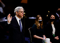 Judge Merrick Garland is sworn in to testify before a Senate Judiciary Committee hearing on his nomination to be U.S. Attorney General as family members listen on Capitol Hill in Washington, U.S., February 22, 2021. <br /> Credit: Carlos Barria / Pool via CNP /MediaPunch