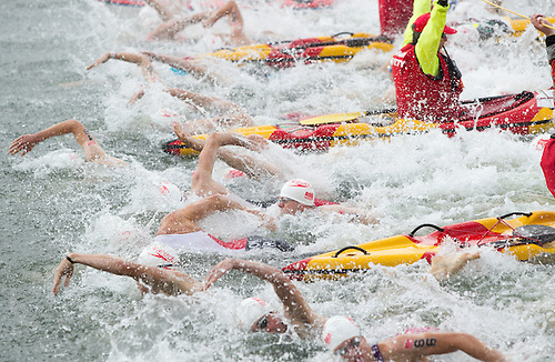 28 JUL 2013 - LONDON, GBR - Competitors start their swim during the Elite Men's race in the 2013 Virgin Active London Triathlon at Excel, Royal Victoria Dock in London, Great Britain (PHOTO COPYRIGHT © 2013 NIGEL FARROW, ALL RIGHTS RESERVED)