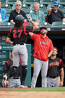 Indianapolis Indians Cole Tucker (27) high fives manager Brian Esposito after hitting a home run during an International League game against the Buffalo Bisons on June 20, 2019 at Sahlen Field in Buffalo, New York.  Buffalo defeated Indianapolis 11-8  (Mike Janes/Four Seam Images)