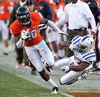 CHARLOTTESVILLE, VA- NOVEMBER 12: Wide receiver Kris Burd #18 of the Virginia Cavaliers runs with the ball during the game against the Duke Blue Devils on November 12, 2011 at Scott Stadium in Charlottesville, Virginia. Virginia defeated Duke 31-21. (Photo by Andrew Shurtleff/Getty Images) *** Local Caption *** Kris Burd