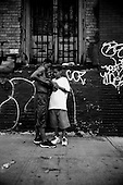 Brooklyn, New York<br /> July 4, 2003 <br /> <br /> Celebrating Independence Day in the street.