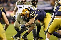 Philadelphia, PA - December 14, 2019:    Navy Midshipmen linebacker Diego Fagot (54) tackles Army Black Knights quarterback Christian Anderson (13) during the 120th game between Army vs Navy at Lincoln Financial Field in Philadelphia, PA. (Photo by Elliott Brown/Media Images International)