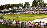 Phil Mickelson and JJ Henry make their way up the 18th  fairway during the final round of the Quail Hollow Championship at Quail Hollow Country Club on May 2, 2010 in Charlotte, North Carolina.  The event, formerly called the Wachovia Championship, is a top event on the PGA Tour, attracting such popular golf icons as Tiger Woods, Vijay Singh and Bubba Watson. Photo from the final round in the Quail Hollow Championship golf tournament at the Quail Hollow Club in Charlotte, N.C., Sunday , May 03, 2009..