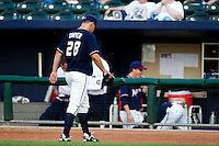 Chris Dwyer (28) of the Northwest Arkansas Naturals walks off the field after being taken out during a game against the San Antonio Missions at Arvest Ballpark on June 30, 2011 in Springdale, Arkansas. (David Welker / Four Seam Images)