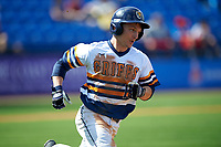 Canisius College Golden Griffins left fielder Tim Kensinger (10) runs to first base during the second game of a doubleheader against the Michigan Wolverines on February 20, 2016 at Tradition Field in St. Lucie, Florida.  Michigan defeated Canisius 3-0.  (Mike Janes/Four Seam Images)