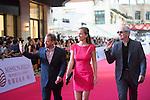 Art Marcum and his companion Jenny, Marc Butan, and Michael Shamberg walk the Red Carpet event at the World Celebrity Pro-Am 2016 Mission Hills China Golf Tournament on 20 October 2016, in Haikou, China. Photo by Weixiang Lim / Power Sport Images