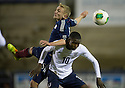 Scotland's Sean McKirdy and England's Foday Nabay challenge for the ball.
