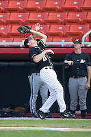 First baseman Tom Hagan (26) of the Hickory Crawdads makes a catch near the Kannapolis Intimidators dugout at L.P. Frans Stadium in Hickory, NC, Sunday, August 17, 2008.