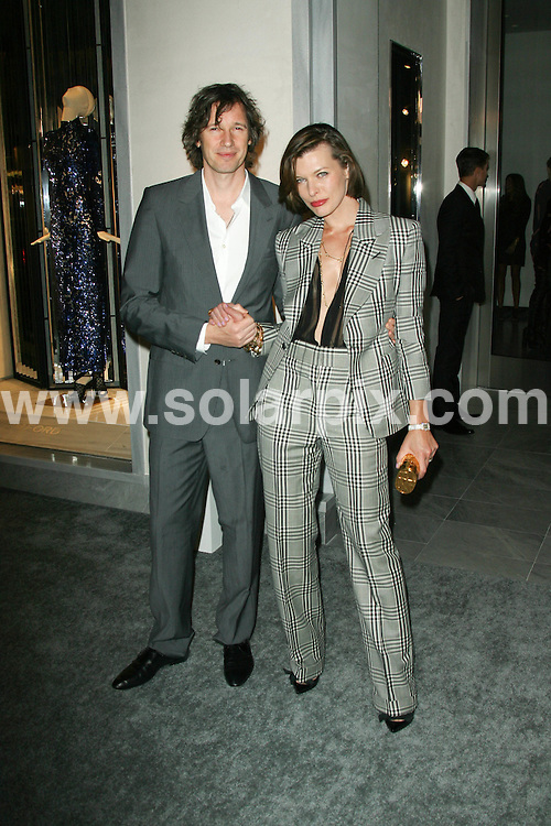 **ALL ROUND PICTURES FROM SOLARPIX.COM**                                             **SYNDICATION RIGHTS FOR UK, AUSTRALIA, DENMARK, PORTUGAL, S. AFRICA, SPAIN & DUBAI (U.A.E) & ASIA (EXCLUDING JAPAN) ONLY**                                                                                  Caption: arrivals at the Tom Ford Beverly Hills Flagship Store Opening Celebration, Beverly Hills, CA, USA. 24 February 2011                                                                           This pic: Paul W.S. Anderson and Milla Jovovich                                                                             JOB REF: 12890 PHZ Evans      DATE: 24_02_2011                                                           **MUST CREDIT SOLARPIX.COM OR DOUBLE FEE WILL BE CHARGED**                                                                      **MUST AGREE FEE BEFORE ONLINE USAGE**                               **CALL US ON: +34 952 811 768 or LOW RATE FROM UK 0844 617 7637**