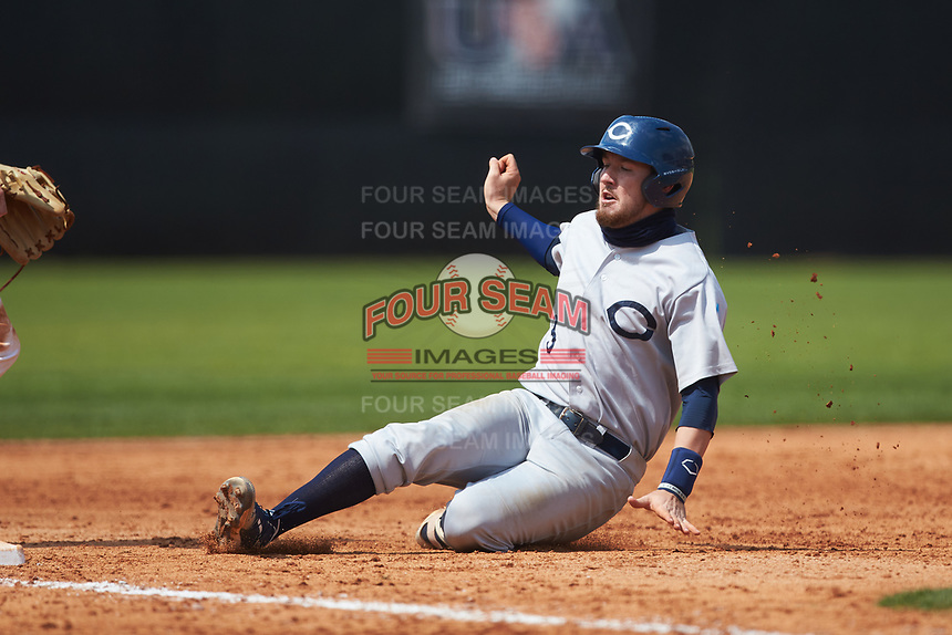 Jeremy Simpson (3) of the Catawba Indians slides into third base against the Queens Royals during game one of a double-header at Tuckaseegee Dream Fields on March 26, 2021 in Kannapolis, North Carolina. (Brian Westerholt/Four Seam Images)