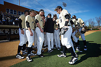 The Wake Forest Demon Deacons huddle up prior to the game against the Gardner-Webb Runnin' Bulldogs at David F. Couch Ballpark on February 18, 2018 in  Winston-Salem, North Carolina. The Demon Deacons defeated the Runnin' Bulldogs 8-4 in game one of a double-header.  (Brian Westerholt/Four Seam Images)