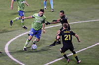 COLUMBUS, OH - DECEMBER 12: Shane O'Neill #27 of the Seattle Sounders FC is defended by Artur #8 and Aidan Morris #21 of the Columbus Crew during a game between Seattle Sounders FC and Columbus Crew at MAPFRE Stadium on December 12, 2020 in Columbus, Ohio.