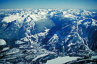 Aerial View of Whistler Village, with Whistler and Blackcomb ski areas behind. Winter sport, resort, vacation, skiing, mountains,cold, snow. Whistler British Columbia Canada.