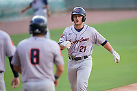 Erik Ostberg (21) of the Bowling Green Hot Rods celebrates a grand slam home run with Jonathan Aranda (8) during a game against the Greenville Drive on Thursday, May 6, 2021, at Fluor Field at the West End in Greenville, South Carolina. (Tom Priddy/Four Seam Images)