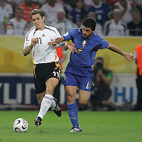 Italian midfielder (8) Gennaro Gattuso tries to take the ball away from German forward (11) Miroslav Klose.  Italy defeated Germany, 2-0, in overtime in their FIFA World Cup semifinal match at FIFA World Cup Stadium in Dortmund, Germany, July 4, 2006.