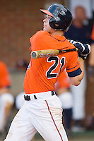 Dan Grovatt #21 of the Virginia Cavaliers follows through on his swing against the St. John's Red Storm at the Charlottesville Regional of the 2010 College World Series at Davenport Field on June 6, 2010, in Charlottesville, Virginia.  The Red Storm defeated the Cavaliers 6-5.   Photo by Brian Westerholt / Four Seam Images