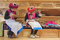 Diqing Tibetan Autonomous Prefecture, Yunnan Province, China - Tibetan women make traditional handicrafts at home, August 2018.