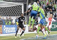 November, 2013: CenturyLink Field, Seattle, Washington: Portland Timbers goalkeeper Donovan Ricketts (1) focuses on the ball as Seattle Sounders FC defender Djimi Trure (19) tries to head the ball  as the Portland Timbers defeat  the Seattle Sounders FC 2-1 in the Major League Soccer Playoffs semifinals Round.