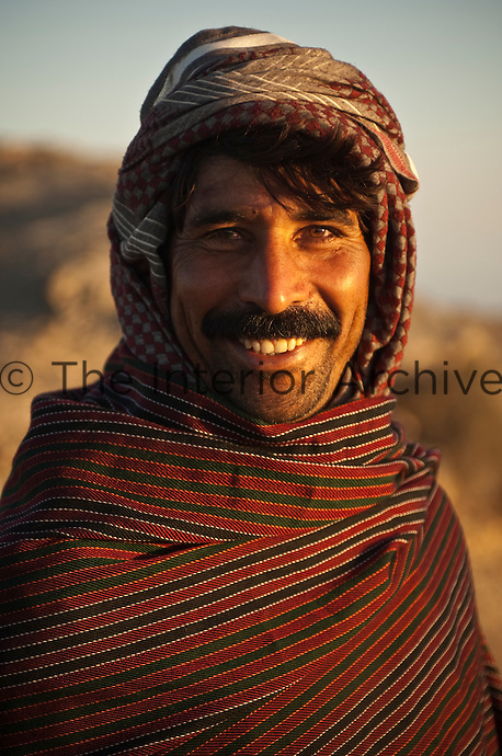 Portrait of an Omani man with traditional head dress