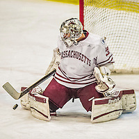 24 November 2013: University of Massachusetts Goaltender Steve Mastalerz, a Junior from North Andover, MA, makes a third period save against the University of Vermont Catamounts at Gutterson Fieldhouse in Burlington, Vermont. The Cats shut out the Minutemen 2-0 to sweep the 2-game home-and-away weekend Hockey East Series. Mandatory Credit: Ed Wolfstein Photo *** RAW (NEF) Image File Available ***