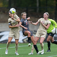 Newton, Massachusetts - October 25, 2015: NCAA Division I. In overtime, Boston College (gold) defeated University of Miami (charcoal gray), 5-4, at Newton Campus Soccer Field. <br /> Gracie Lachowecki flicks throw in for a score.