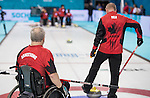 Sochi, RUSSIA - Mar 7 2014 -  Jim Armstrong and Joe Rea of Canada's Wheelchair Curling Team trains before the Sochi 2014 Paralympic Winter Games in Sochi, Russia.  (Photo: Matthew Murnaghan/Canadian Paralympic Committee)