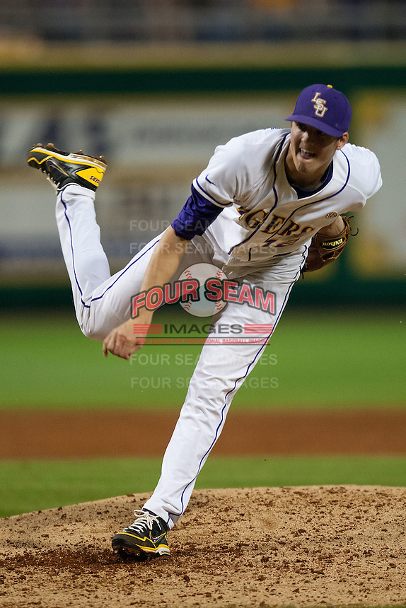 LSU Tigers starting pitcher Kevin Gausman #12 follows through against the Mississippi State Bulldogs during the NCAA baseball game on March 16, 2012 at Alex Box Stadium in Baton Rouge, Louisiana. LSU defeated Mississippi State 3-2 in 10 innings. (Andrew Woolley / Four Seam Images)