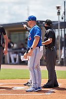 FCL Blue Jays manager Brent Lavallee (60) during the lineup exchange before a game against the FCL Yankees on June 29, 2021 at the Yankees Minor League Complex in Tampa, Florida.  (Mike Janes/Four Seam Images)
