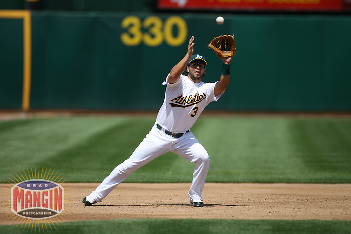 OAKLAND, CA - April 28:  Eric Chavez of the Oakland Athletics catches a line drive during the game against the Tampa Bay Devil Rays at the McAfee Coliseum in Oakland, California on April 28, 2007.  The Athletics defeated the Devil Rays 12-5.  Photo by Brad Mangin