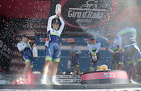 Johan Esteban Chaves (COL/Orica-GreenEDGE) enjoying the team victory with a champaign shower on the podium<br /> <br /> finish podium of stage 1: San Lorenzo Al Mare - San remo (TTT/17.6km)