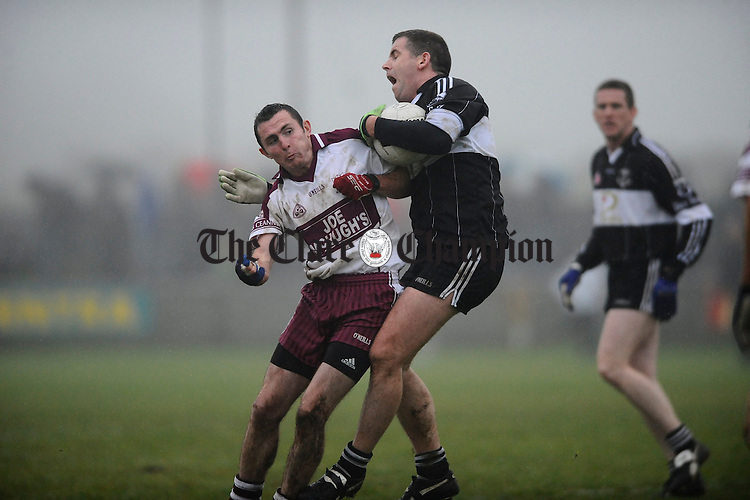 Liscanor's Alan Clohessy and Doonbeg's Kevin Nugent collide during their semi final at Miltown Malbay. Photograph  by John Kelly.